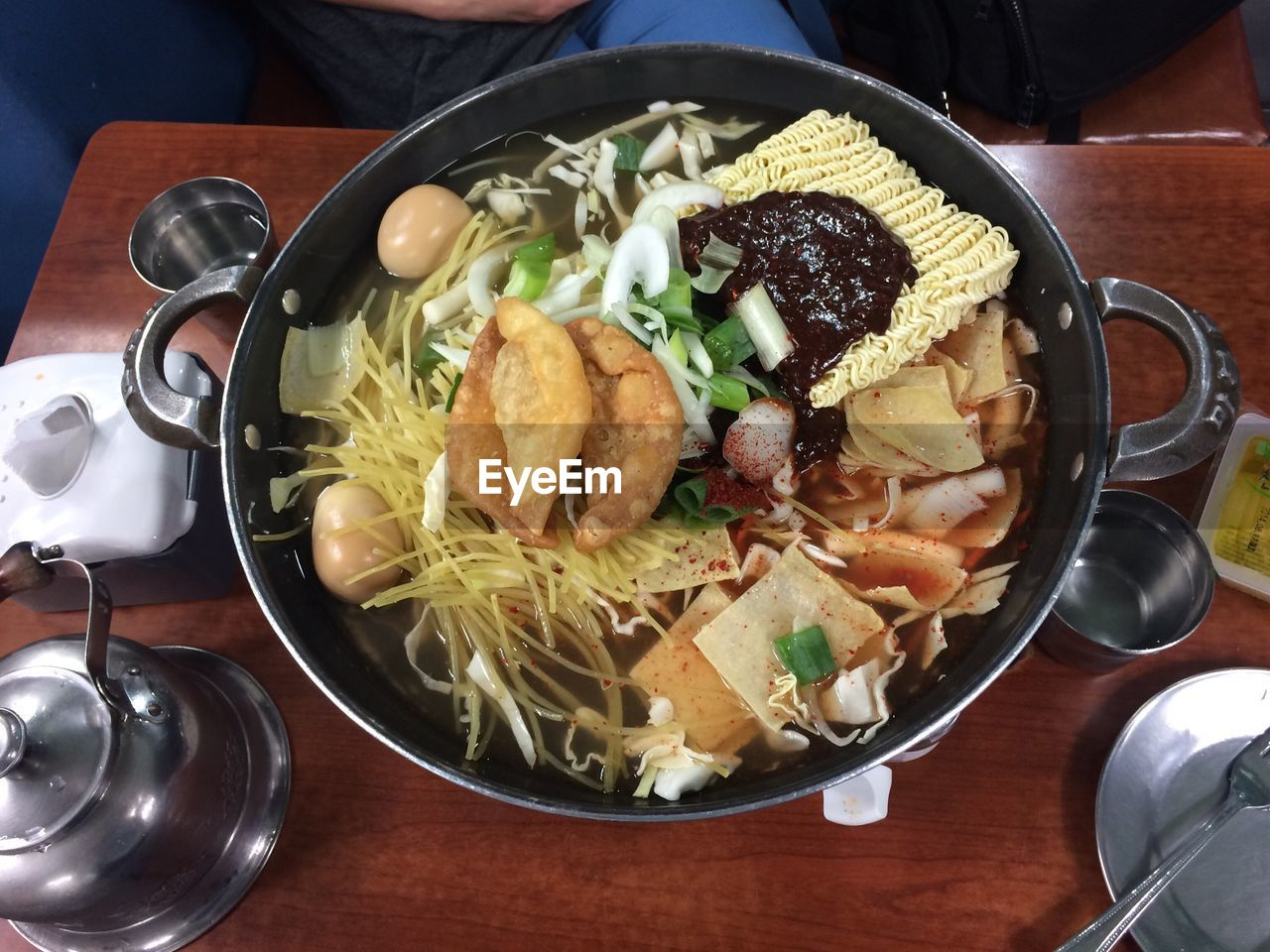 High Angle View Of Korean Food In Cooking Utensil
