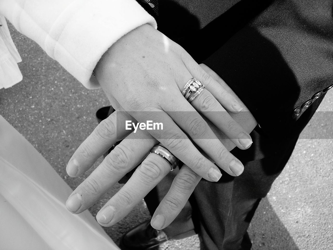 Cropped Image Of Man And Woman Showing Wedding Rings
