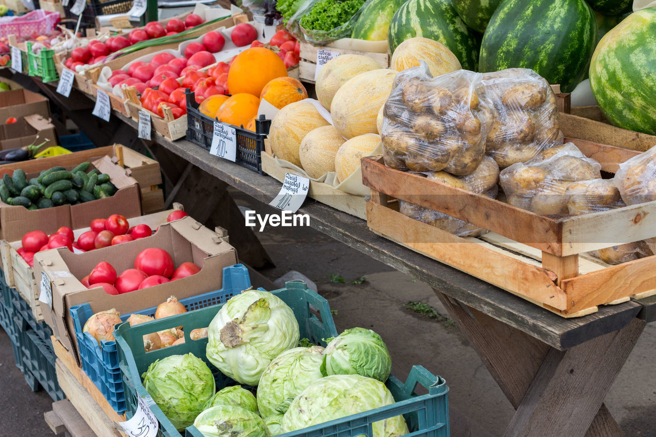 food, food and drink, healthy eating, vegetable, wellbeing, freshness, choice, variation, market, retail, fruit, large group of objects, market stall, box, abundance, for sale, container, cauliflower, business, high angle view, no people, sale, organic, farmer's market, retail display, ripe