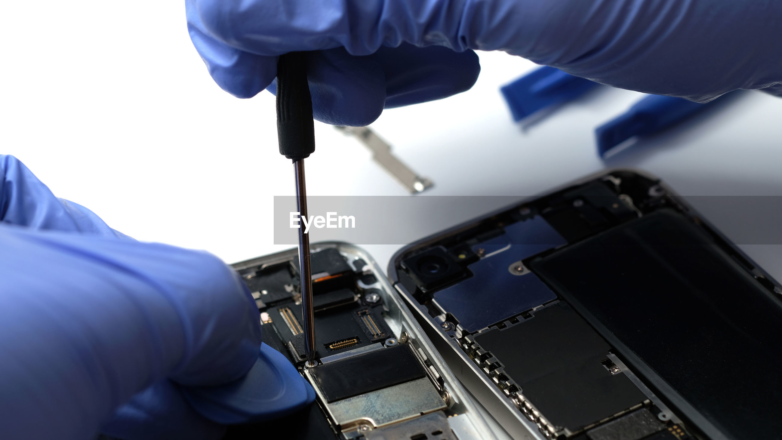 Technician repairing the smartphone's motherboard in the lab with copy space to upgrade technology.