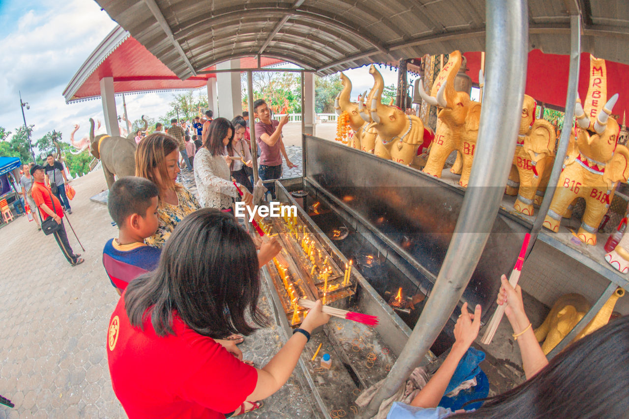 group of people, women, real people, large group of people, lifestyles, men, leisure activity, adult, crowd, day, market, casual clothing, childhood, food, high angle view, child, food and drink, amusement park, outdoors