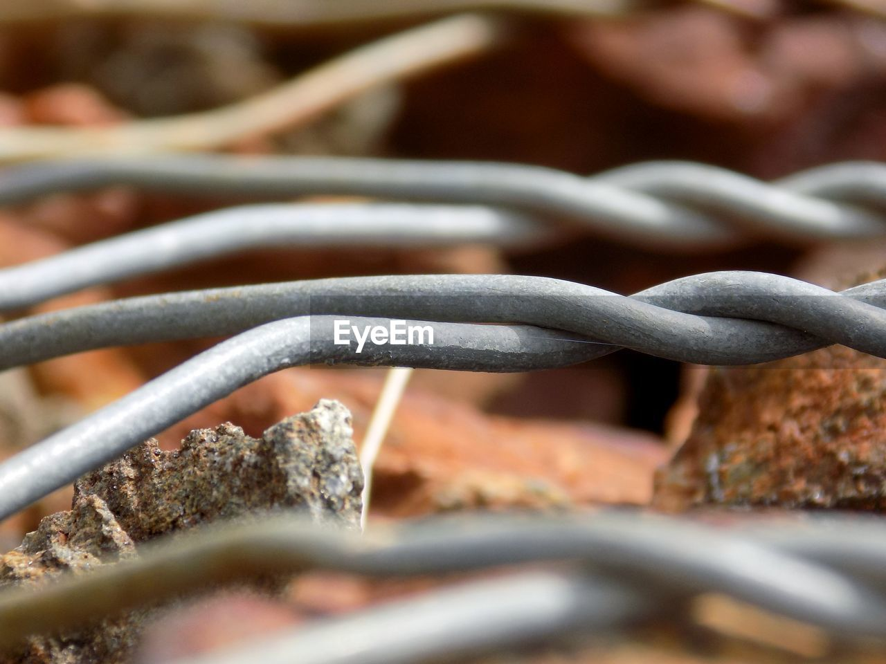 selective focus, close-up, metal, no people, fence, day, barrier, connection, boundary, safety, strength, security, protection, outdoors, nature, focus on foreground, wire, still life, cable, detail, tangled