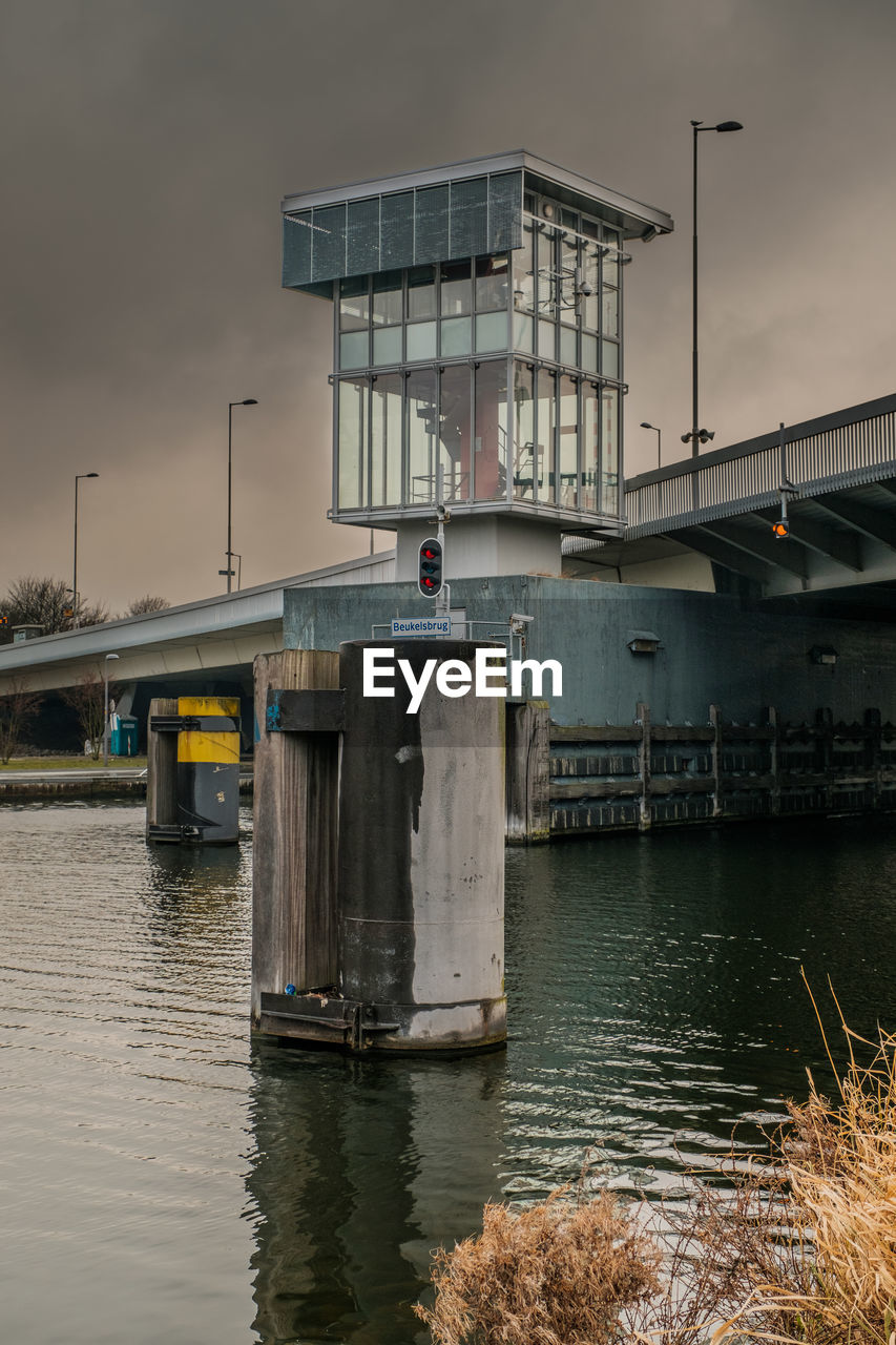 architecture, built structure, water, bridge - man made structure, connection, no people, building exterior, transportation, outdoors, sky, day, nature