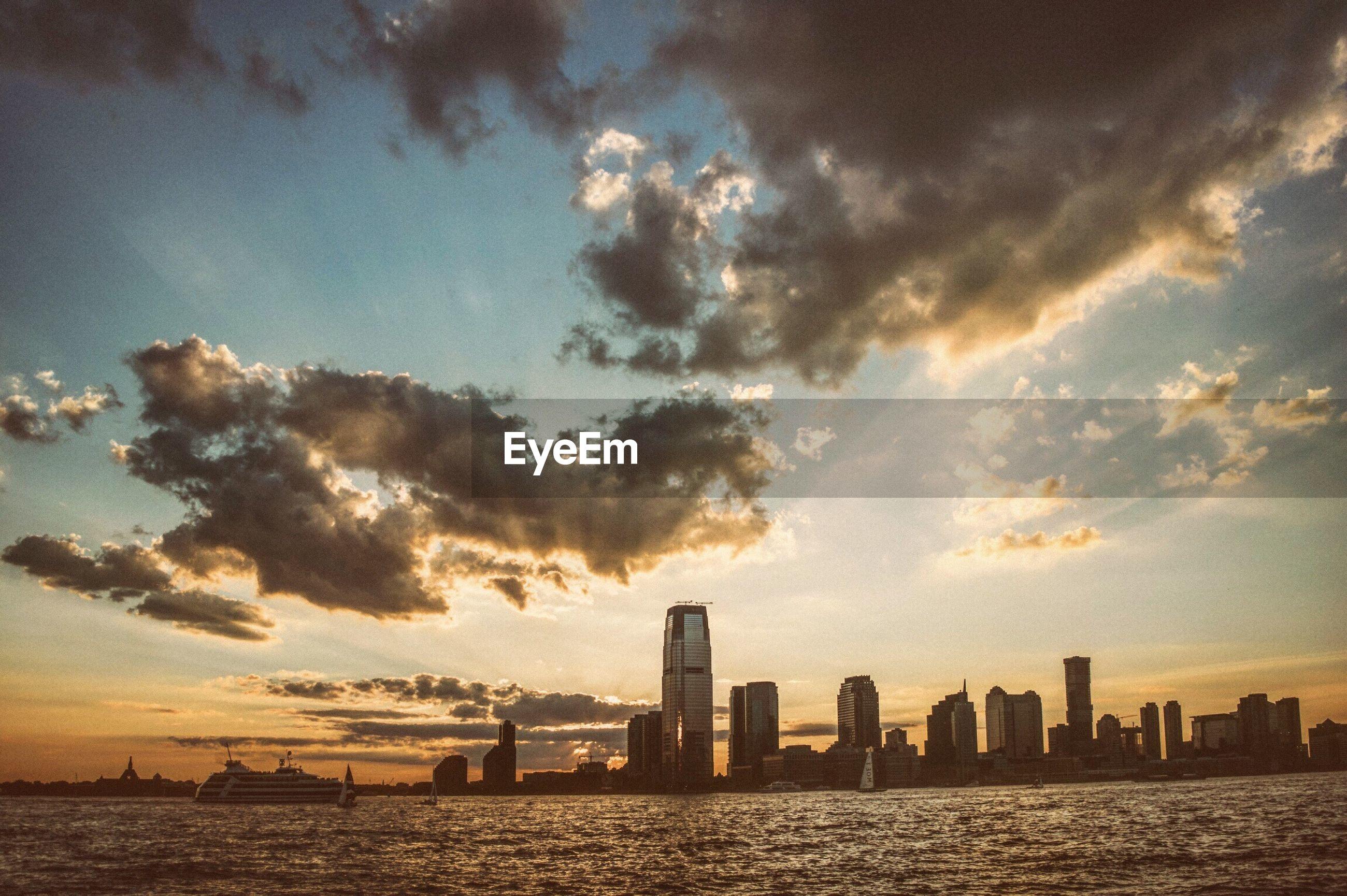 SEA AND CITYSCAPE AGAINST SKY
