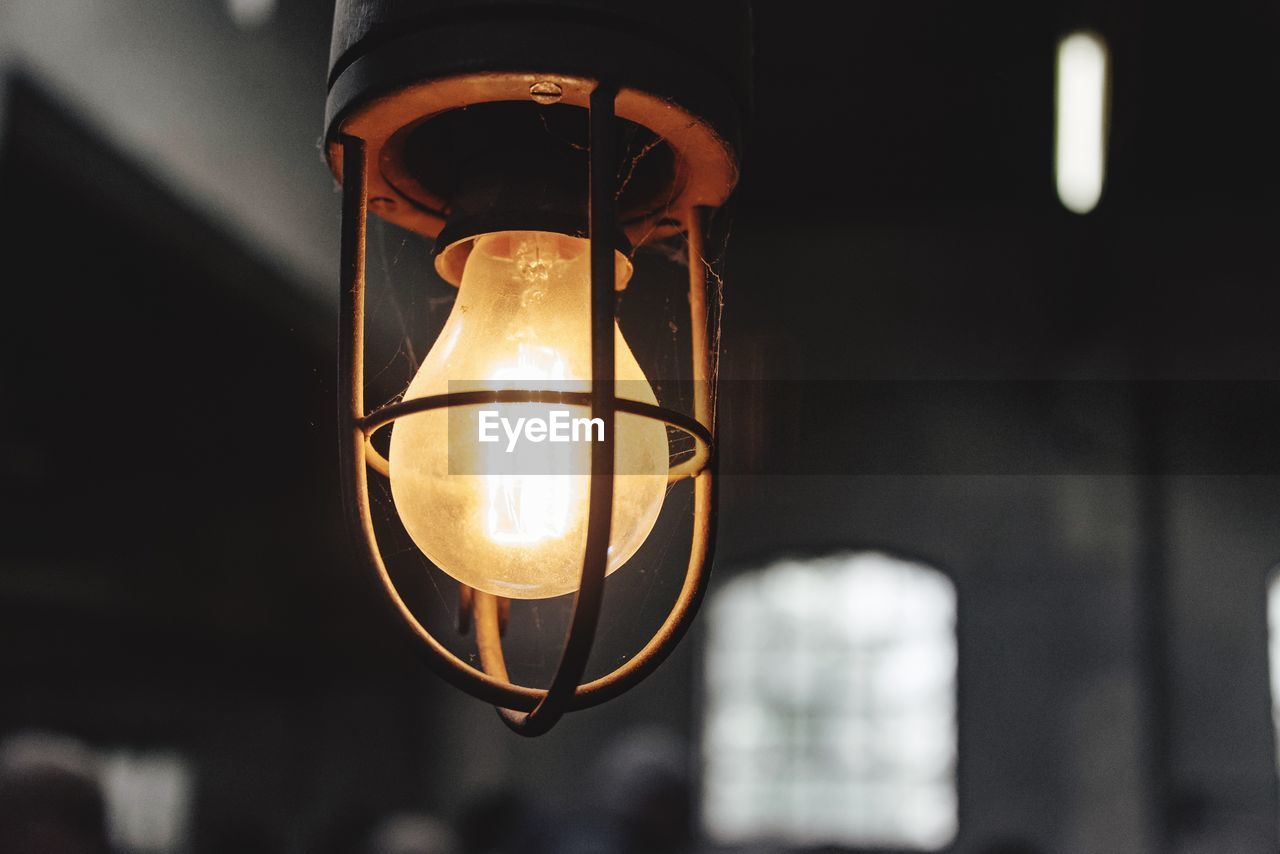 electricity, lighting equipment, illuminated, light bulb, close-up, no people, focus on foreground, glowing, electric light, hanging, technology, filament, low angle view, indoors, day
