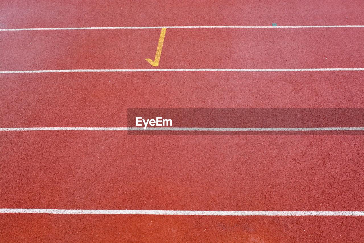 Full frame shot of red running track