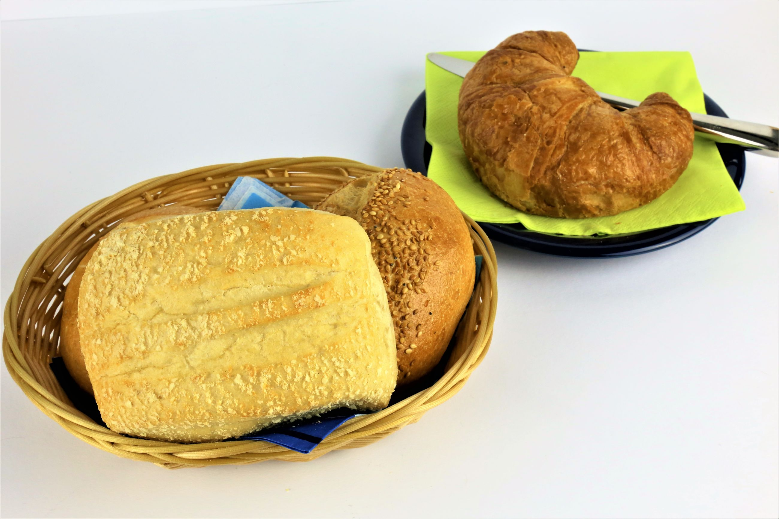 Close-up of breads over white background