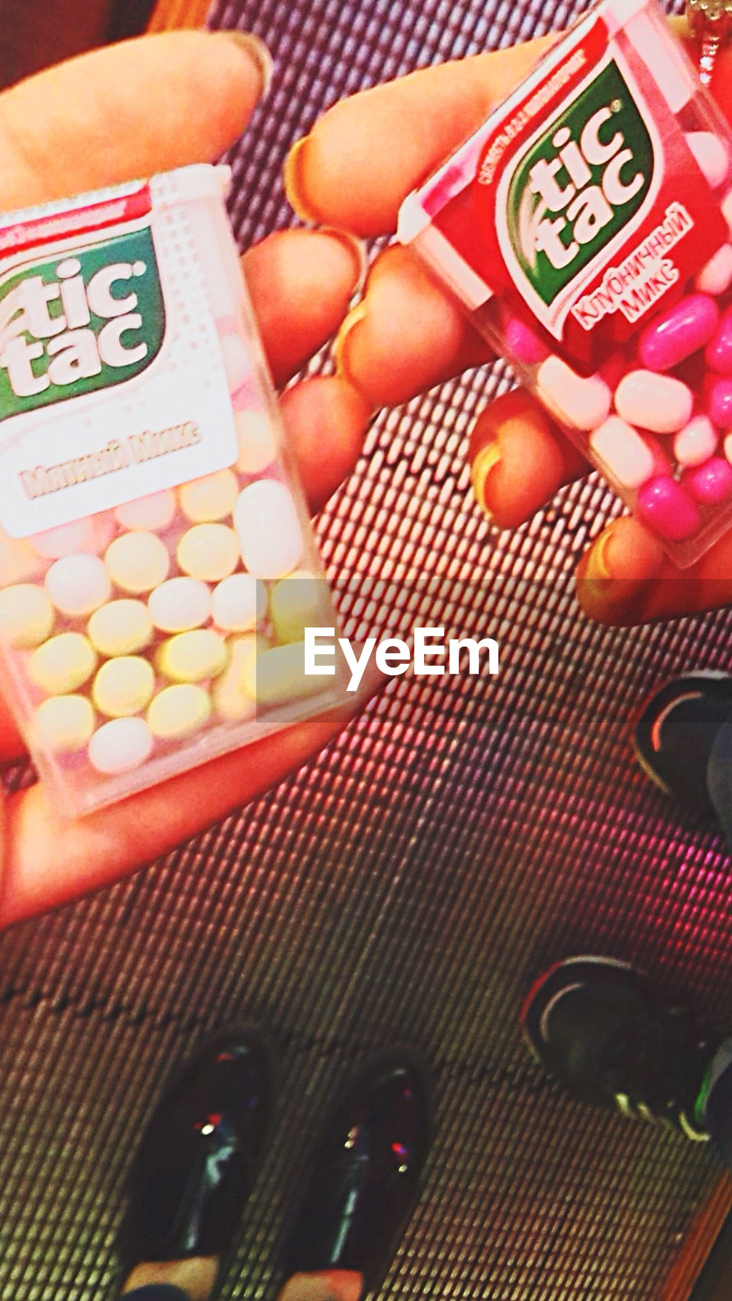 indoors, person, communication, text, part of, cropped, western script, holding, human finger, high angle view, food and drink, close-up, lifestyles, number, technology, unrecognizable person, food