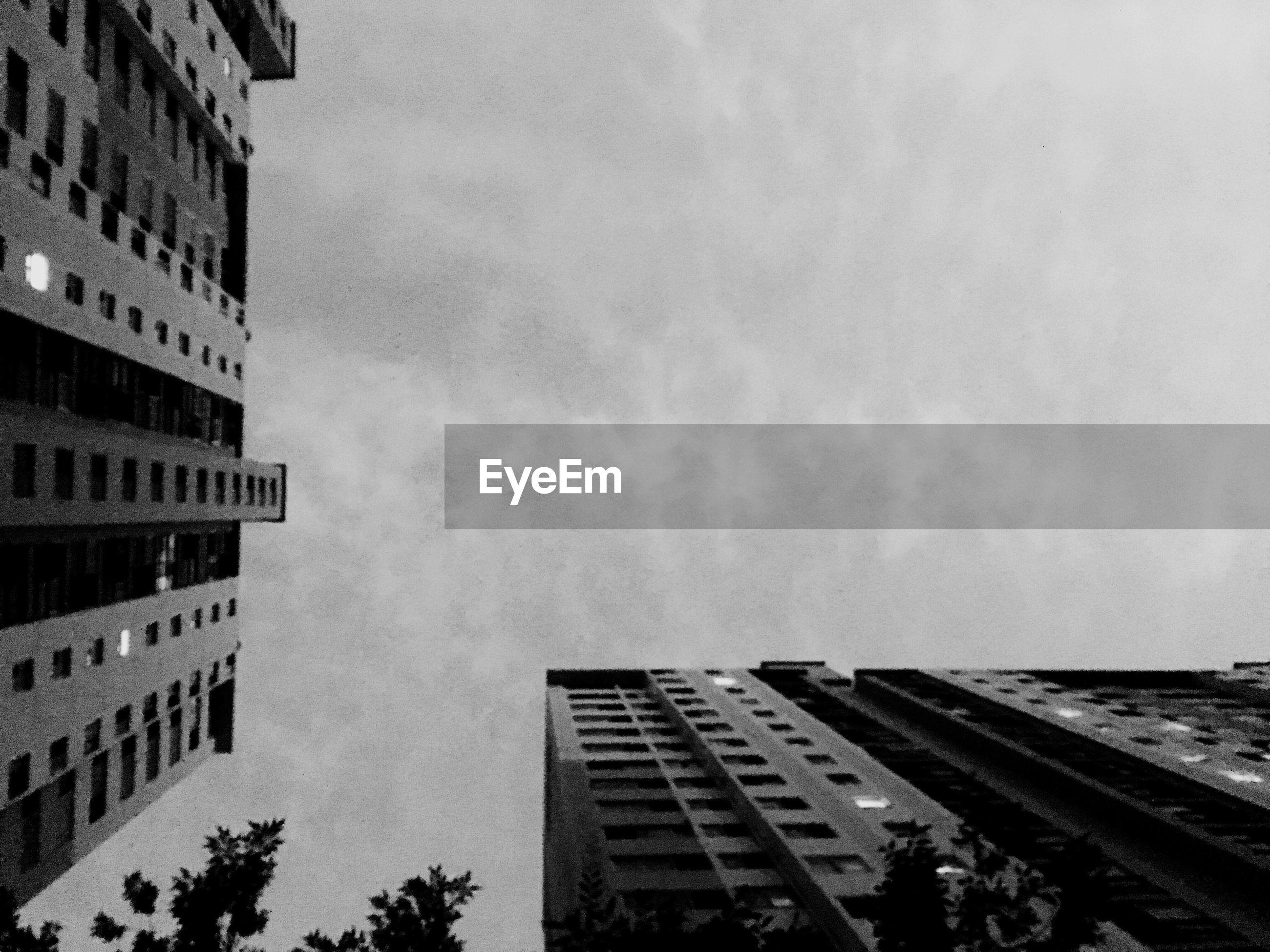 Directly below shot of buildings against sky