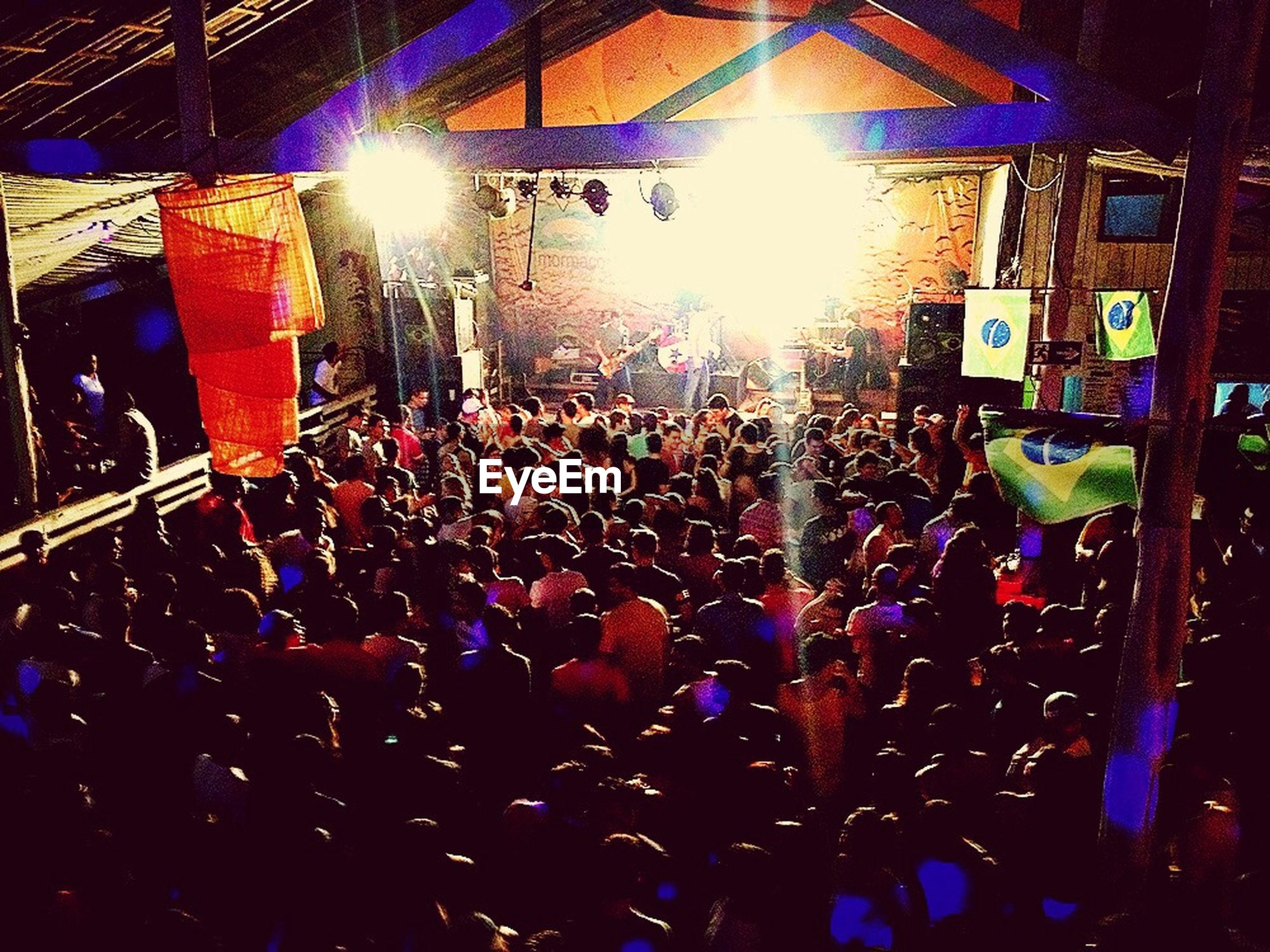 large group of people, crowd, illuminated, night, men, lifestyles, nightlife, person, leisure activity, enjoyment, arts culture and entertainment, music, lighting equipment, popular music concert, event, music festival, concert, performance