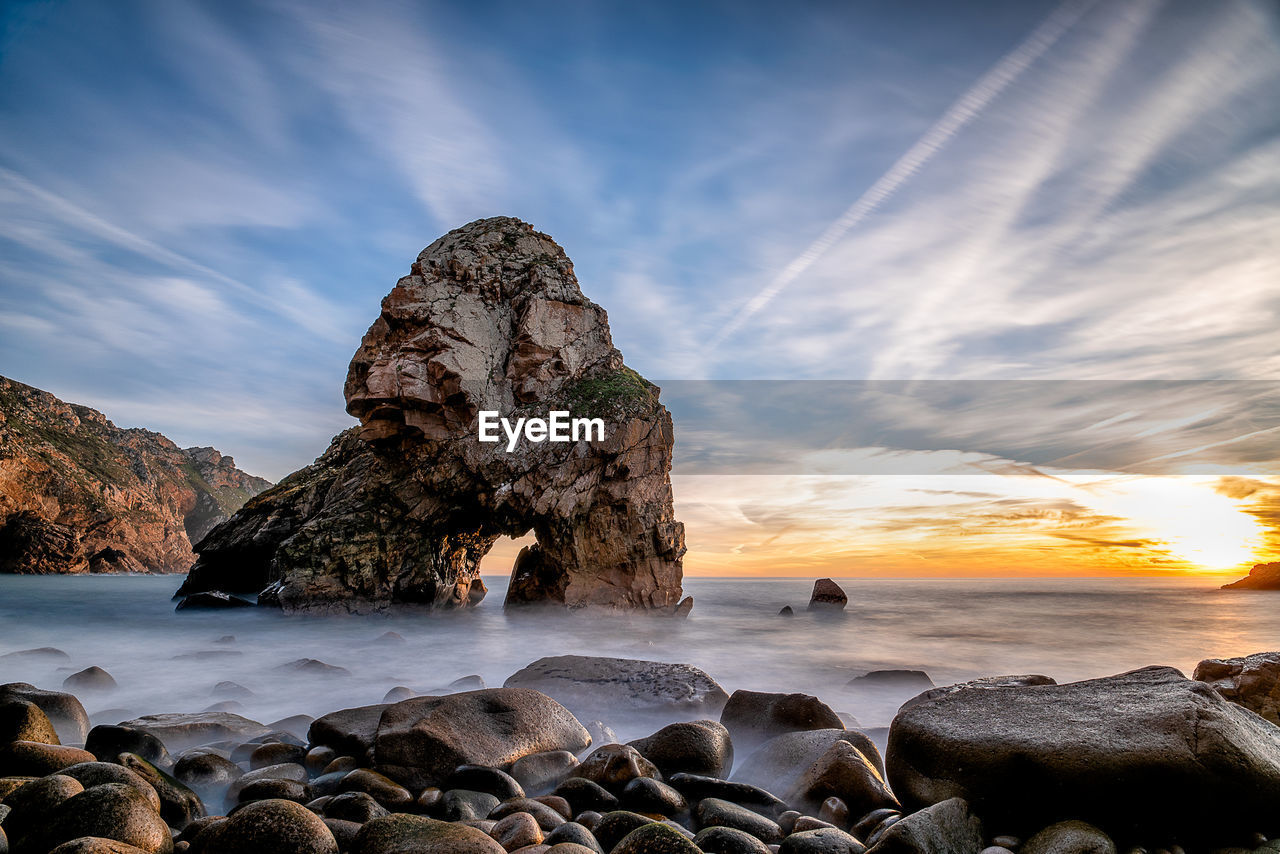 rock, sky, sea, solid, water, rock - object, beauty in nature, scenics - nature, cloud - sky, beach, sunset, rock formation, land, nature, tranquility, idyllic, tranquil scene, motion, horizon over water, no people, outdoors, stack rock, eroded