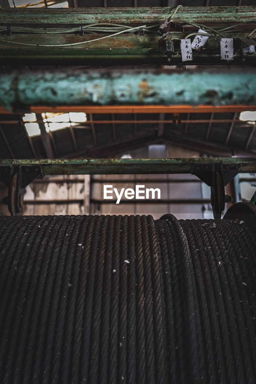 focus on foreground, no people, seat, metal, pattern, day, wood - material, old, abandoned, indoors, absence, empty, bench, close-up, industry, furniture, rusty, nature, loom, park bench