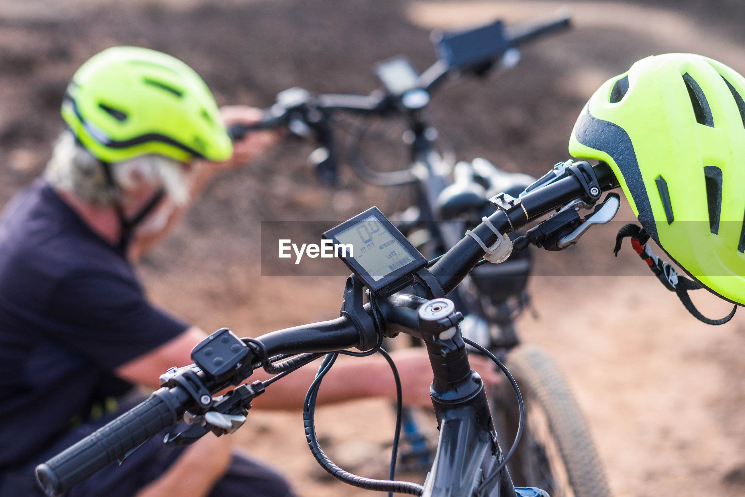 High angle view of helmet on bicycle handle by senior man