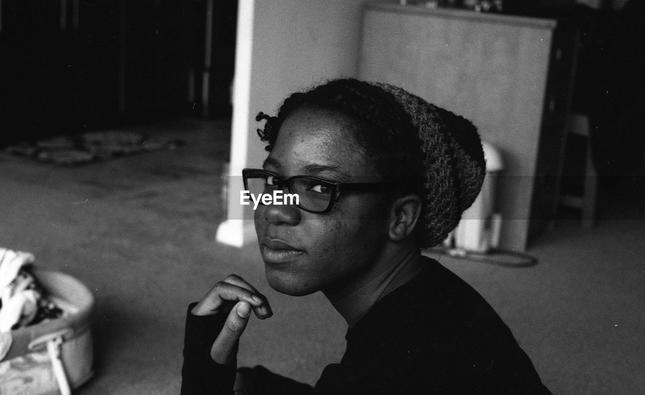 one person, young adult, real people, eyeglasses, portrait, focus on foreground, indoors, looking at camera, headshot, young women, close-up, day, people