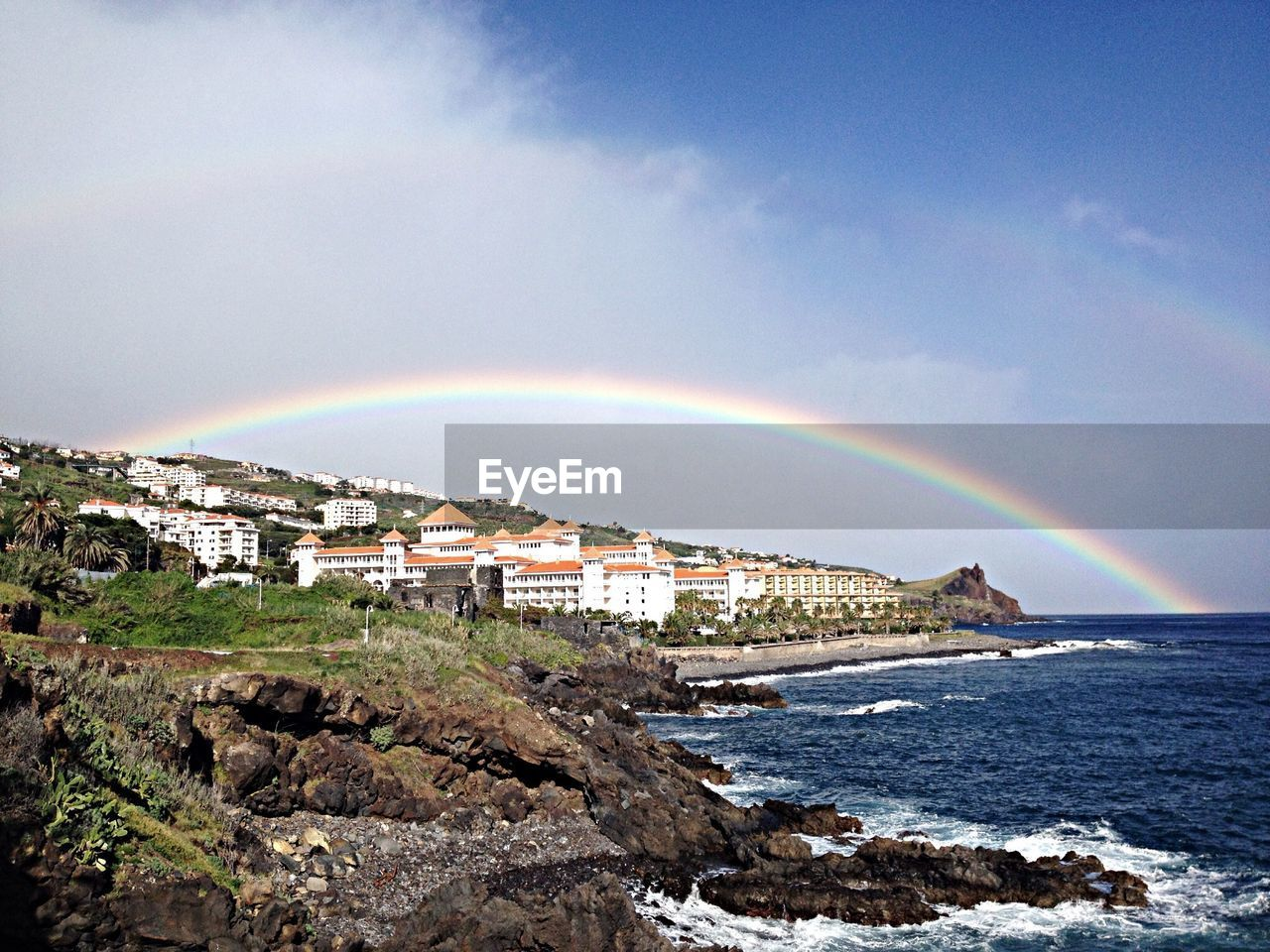 rainbow, water, sky, beauty in nature, scenics - nature, double rainbow, sea, nature, architecture, no people, cloud - sky, arch, built structure, day, multi colored, rock - object, building exterior, idyllic, outdoors