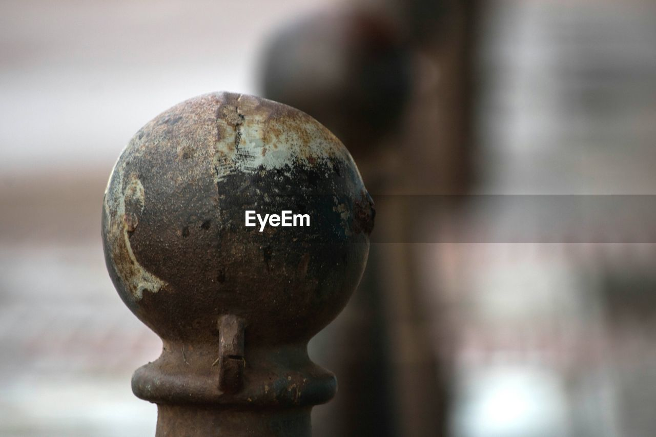 focus on foreground, metal, rusty, close-up, no people, old, day, sphere, weathered, outdoors, run-down, design, art and craft, shape, protection, obsolete, nature, decline, deterioration, safety