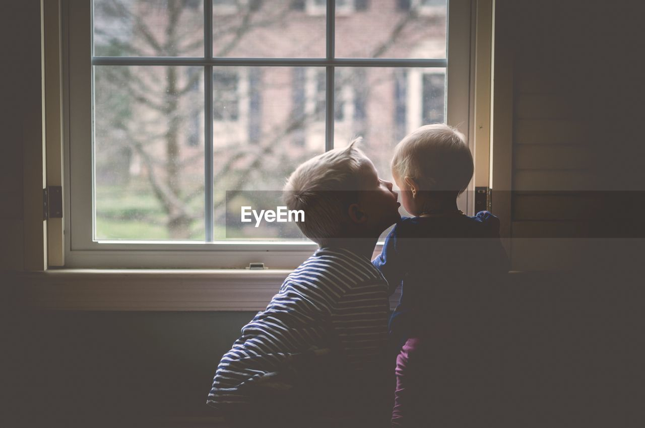 Boys looking through window