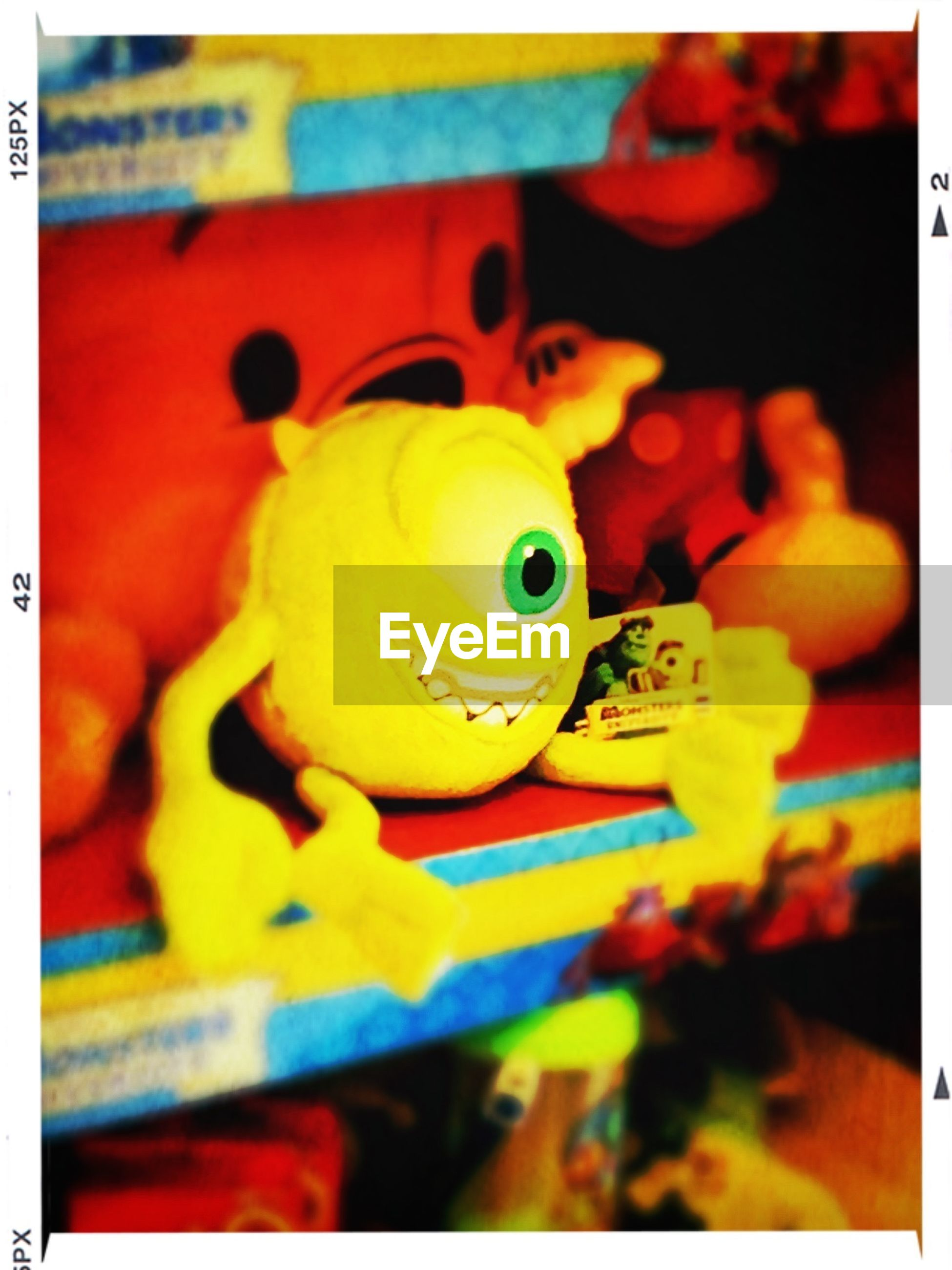 transfer print, auto post production filter, toy, indoors, childhood, close-up, focus on foreground, multi colored, yellow, selective focus, still life, animal representation, human representation, plastic, art and craft, art, creativity, no people, variation, table