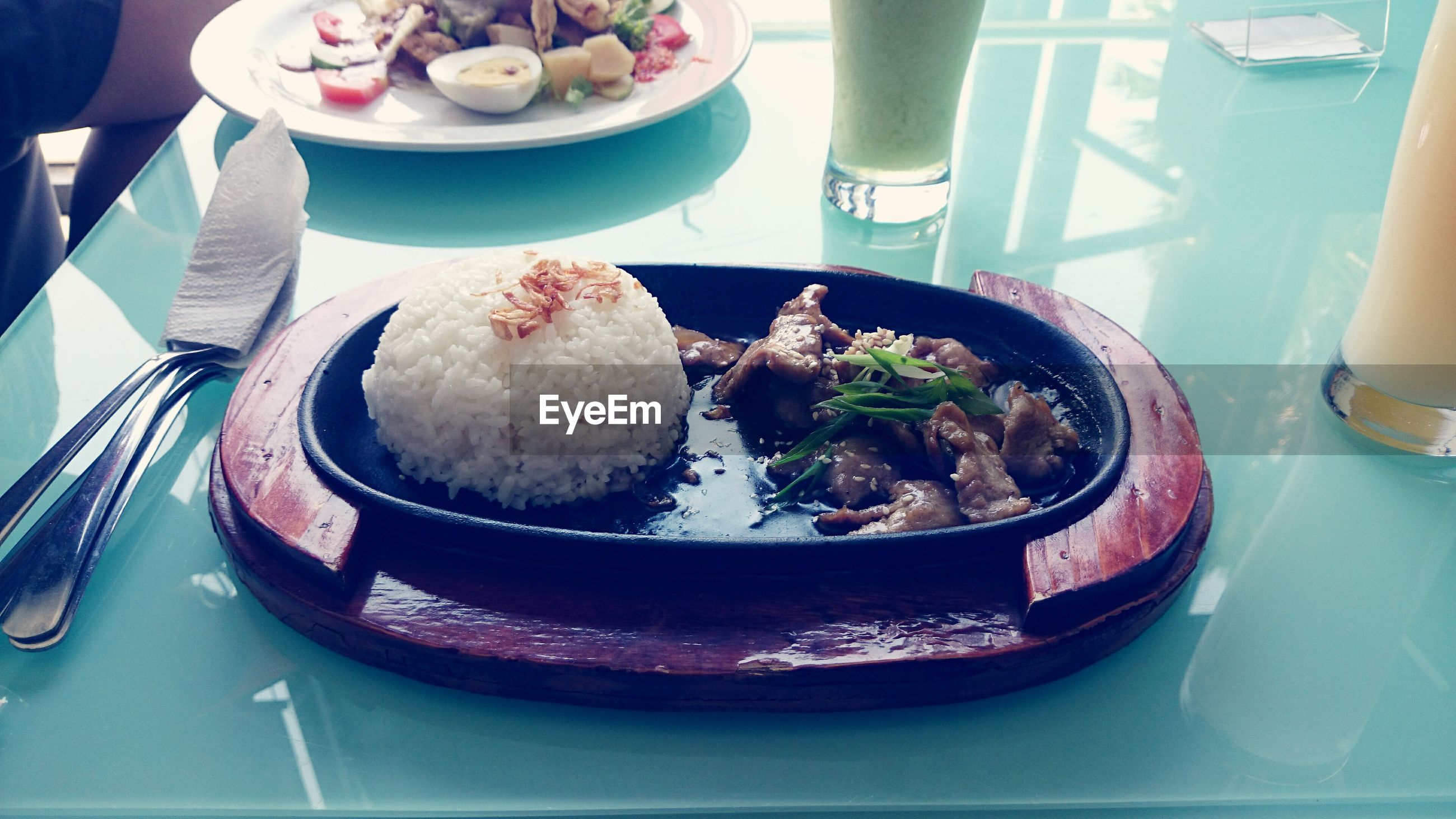 High angle view of meat and rice in plate on table