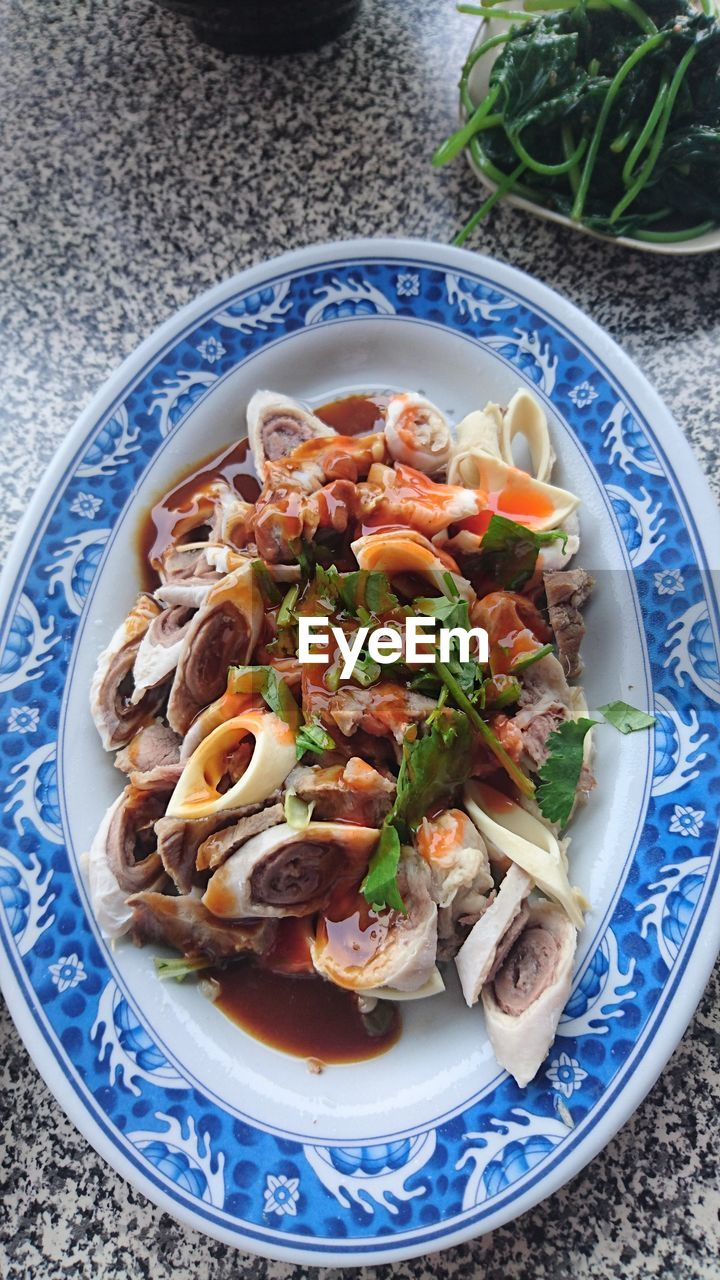 plate, food and drink, ready-to-eat, food, freshness, healthy eating, indoors, serving size, high angle view, no people, bowl, seafood, noodles, table, blue, garnish, chinese food, chopsticks, close-up, day