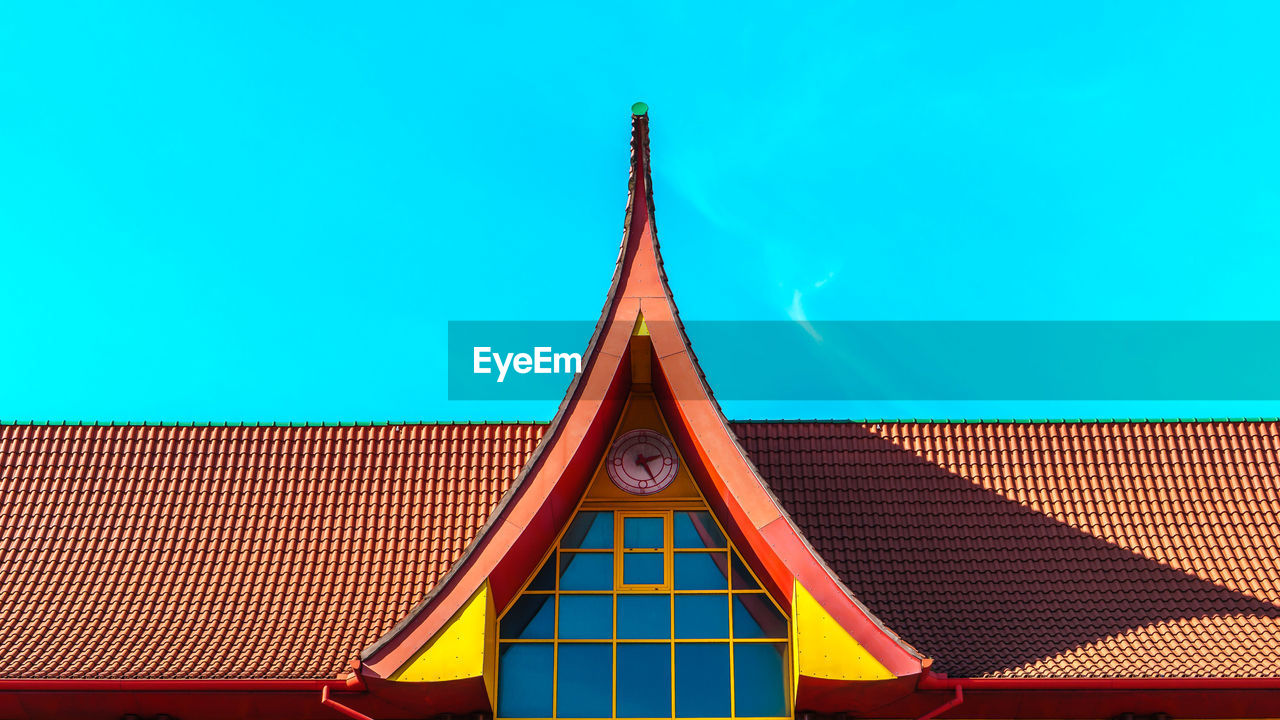 built structure, low angle view, blue, multi colored, architecture, day, roof, no people, clear sky, yellow, building exterior, outdoors, sky, close-up