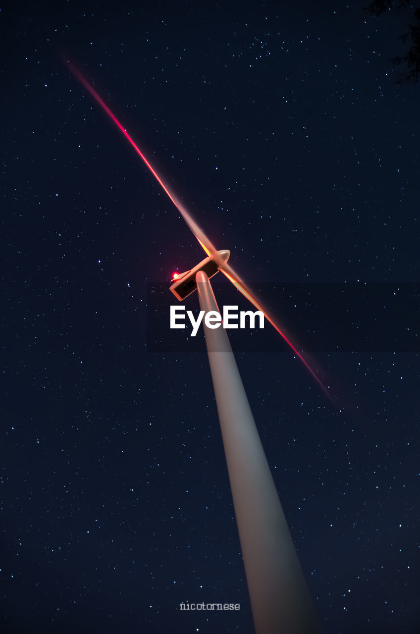 wind power, wind turbine, alternative energy, environmental conservation, night, renewable energy, windmill, low angle view, industrial windmill, star - space, outdoors, fuel and power generation, no people, sky, nature, starry, galaxy, astronomy