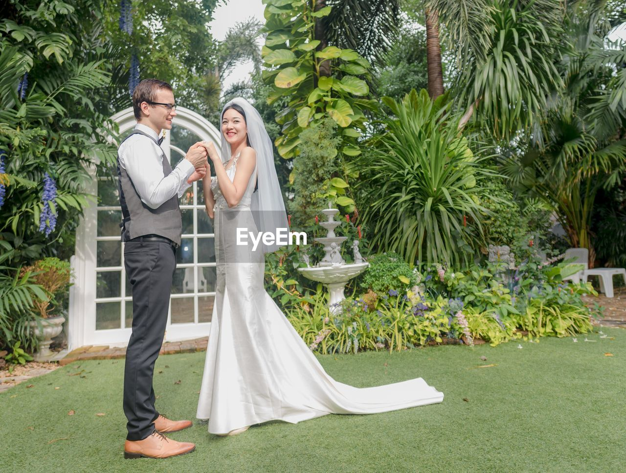 two people, couple - relationship, togetherness, men, women, plant, adult, love, tree, celebration, heterosexual couple, young adult, newlywed, positive emotion, bride, wedding, formalwear, wife, husband, young women, young couple, boyfriend