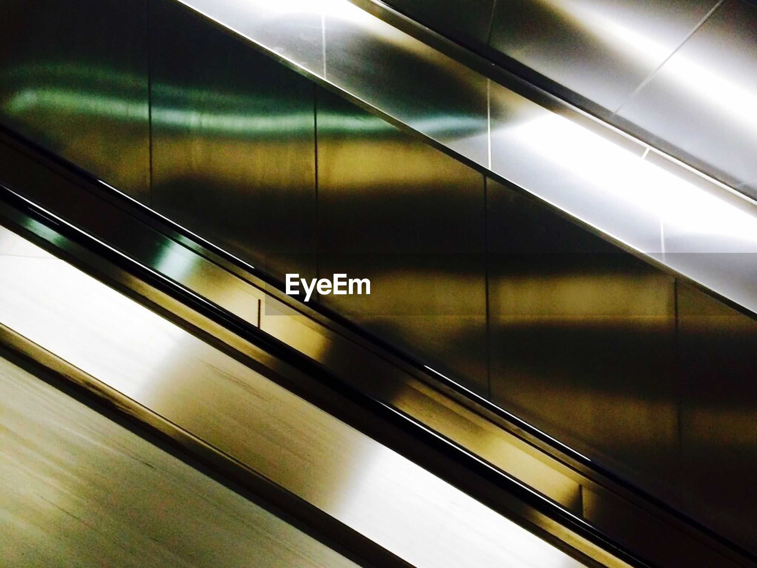 Cropped image of subway station chrome staircase