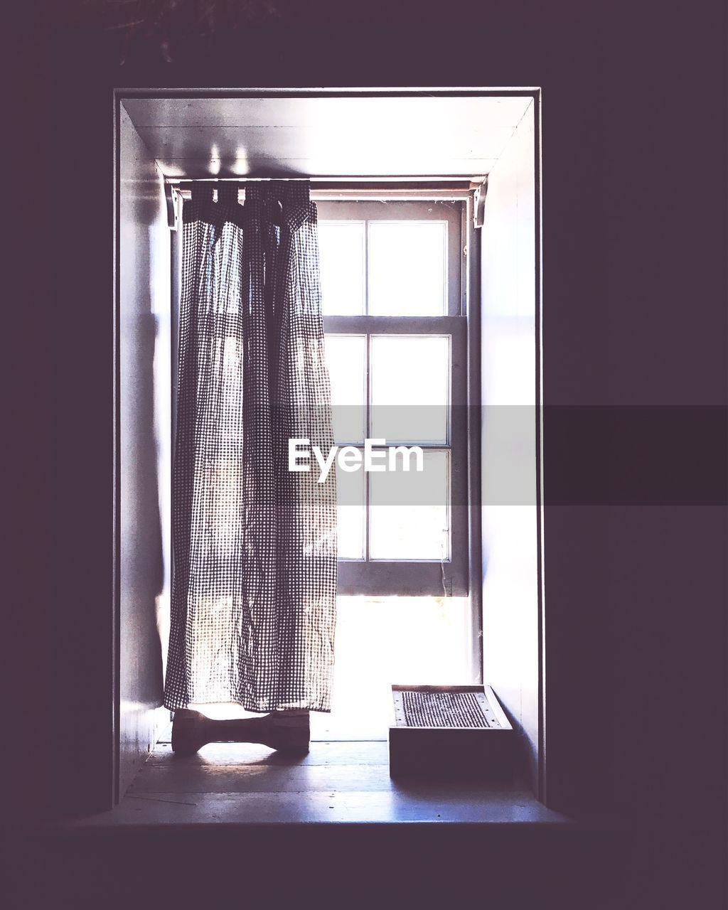 Curtain hanging on window