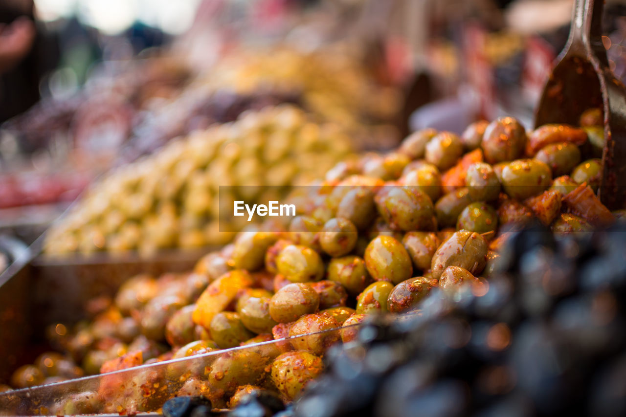 Close-Up Of Spiced Olives For Sale At Market Stall