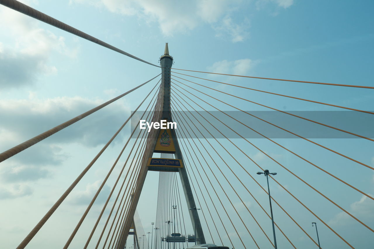built structure, architecture, sky, bridge, bridge - man made structure, connection, engineering, suspension bridge, cable-stayed bridge, cloud - sky, cable, transportation, nature, day, travel destinations, low angle view, travel, tourism, city, outdoors, skyscraper, long