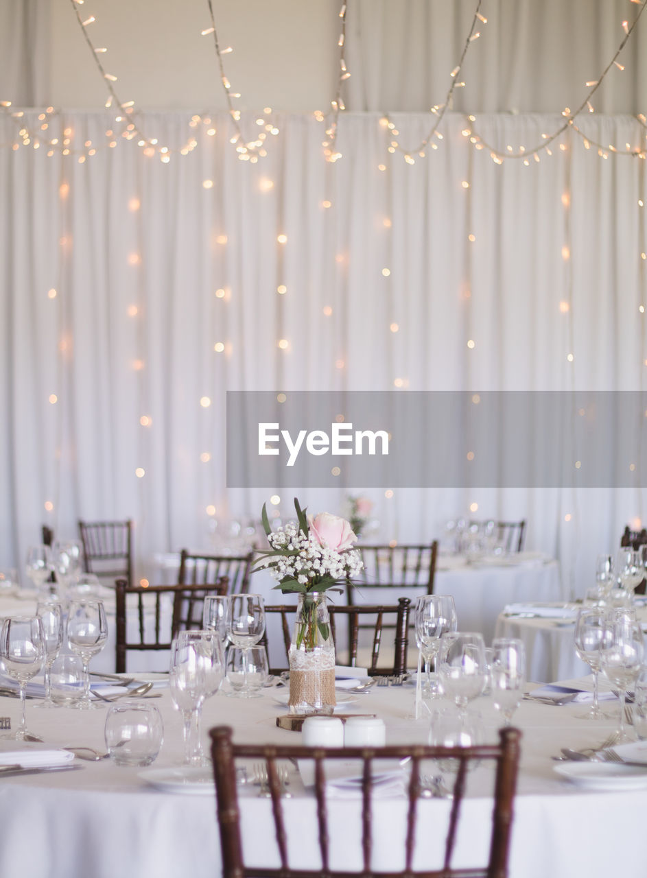 Place settings on dining tables in ceremony