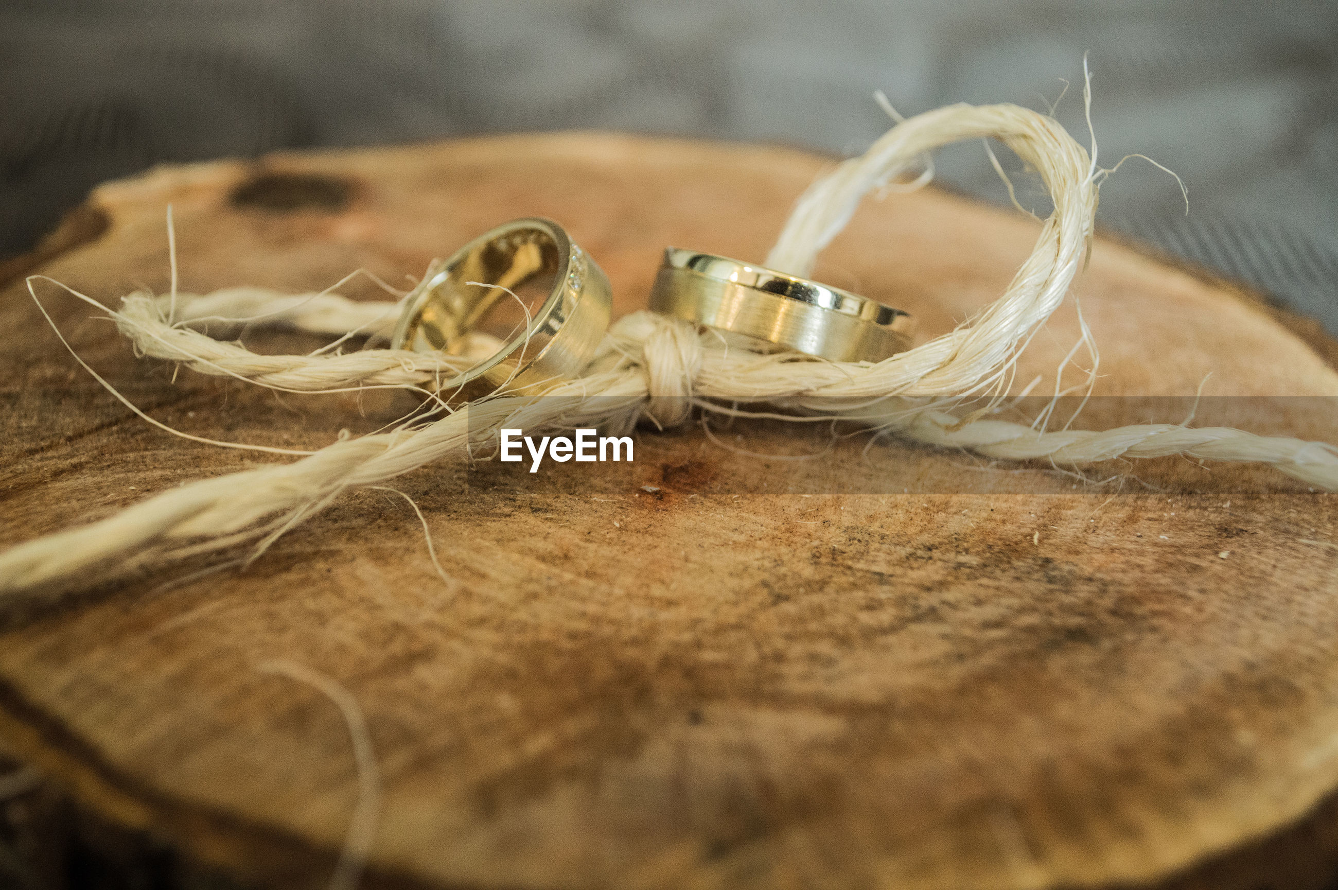 Close-up of wedding rings on wood