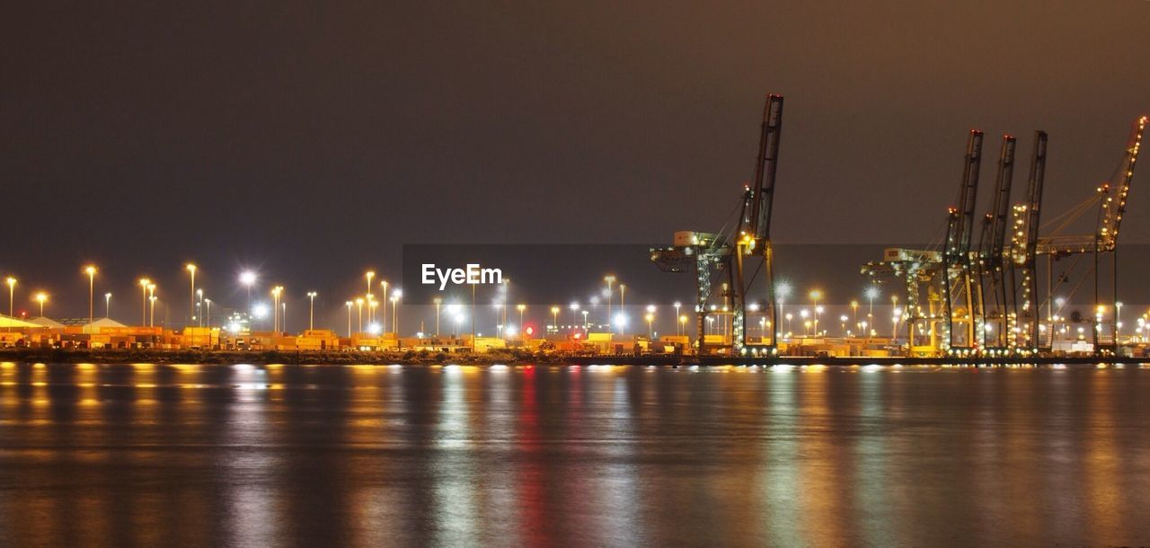 water, illuminated, night, reflection, waterfront, sky, architecture, built structure, building exterior, no people, river, nature, city, outdoors, lighting equipment, glowing, industry, clear sky