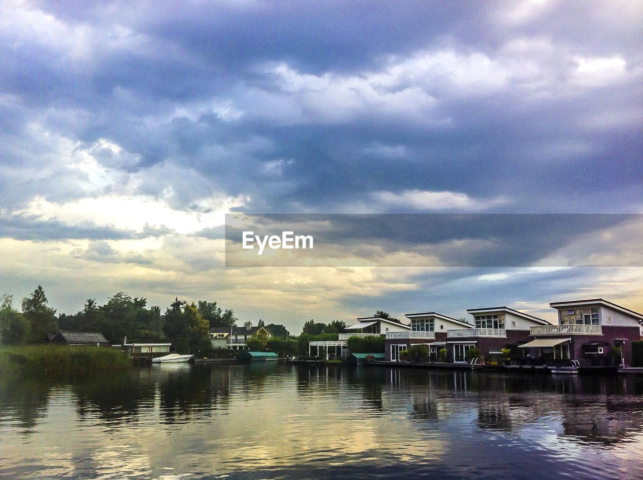 water, sky, architecture, built structure, building exterior, cloud - sky, house, no people, tranquility, reflection, outdoors, tree, tranquil scene, nature, waterfront, lake, day, scenics, beauty in nature