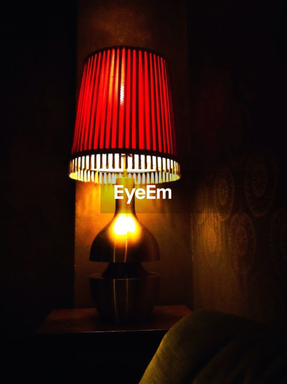 electric lamp, lighting equipment, illuminated, lamp shade, electricity, indoors, glowing, electric light, home interior, side table, light bulb, floor lamp, close-up, red, night, living room, no people, technology, home showcase interior