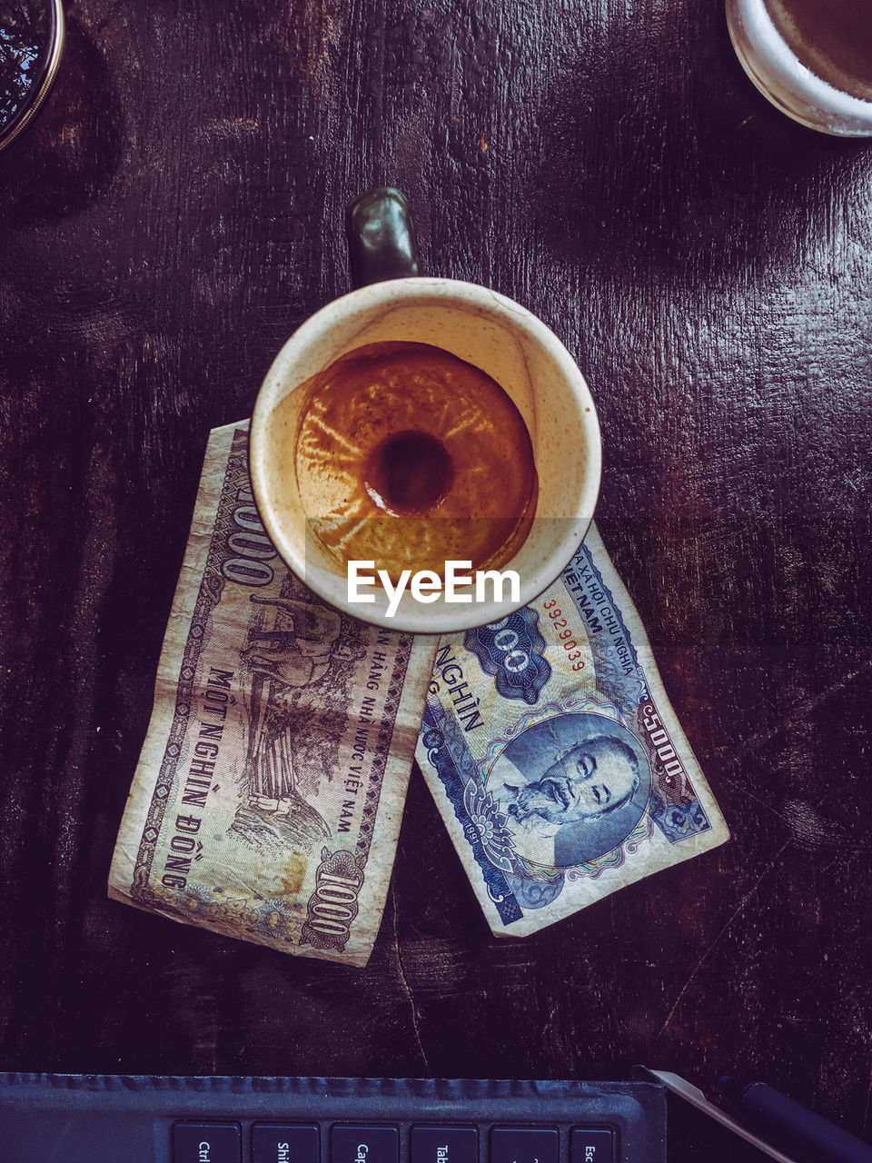 food and drink, table, indoors, still life, cup, directly above, paper currency, coffee, mug, currency, drink, high angle view, no people, freshness, finance, coffee cup, close-up, refreshment, coffee - drink, text, crockery