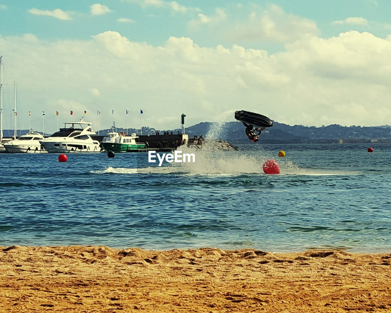 water, sea, cloud - sky, motion, sky, real people, day, leisure activity, speed, outdoors, nature, jet boat, vacations, adventure, wave, beach, one person, lifestyles, men, nautical vessel, beauty in nature, people