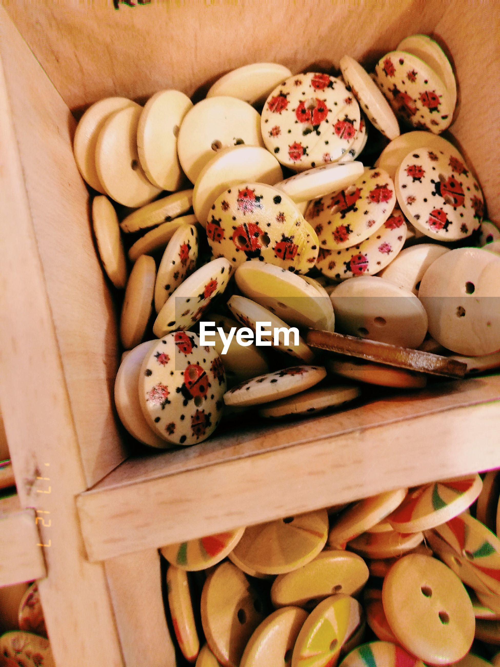 High angle view of cookies in wooden container
