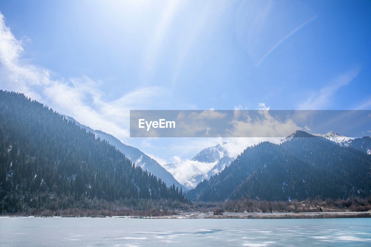 mountain, sky, cloud - sky, scenics - nature, beauty in nature, tranquil scene, tranquility, cold temperature, landscape, nature, winter, snow, environment, mountain range, non-urban scene, idyllic, day, no people, water, outdoors, snowcapped mountain, mountain peak, range