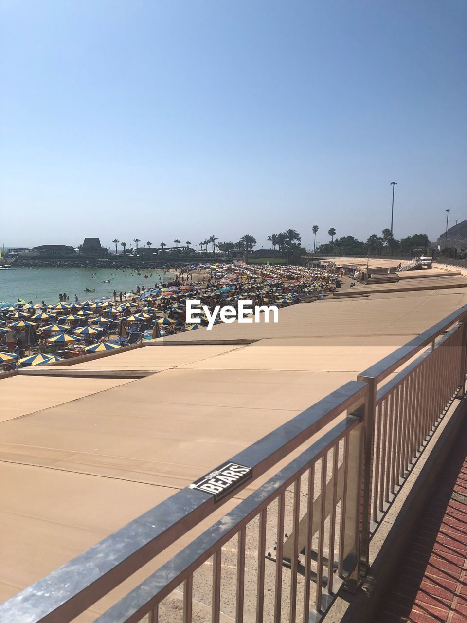 HIGH ANGLE VIEW OF BEACH AGAINST CLEAR SKY