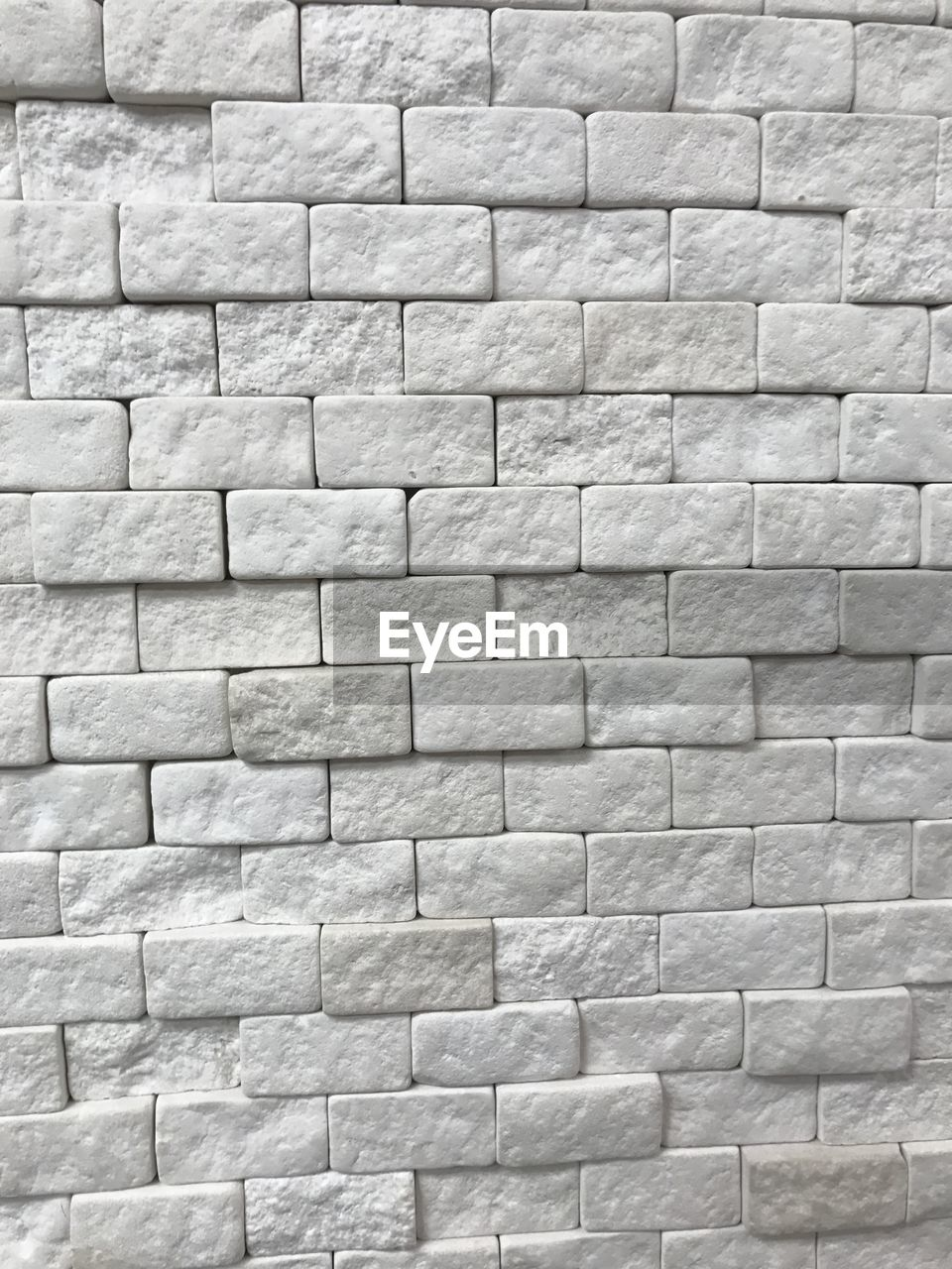 full frame, backgrounds, pattern, textured, wall - building feature, wall, no people, built structure, architecture, brick, close-up, shape, design, white color, stone wall, gray, brick wall, day, rough, repetition, textured effect, concrete, wheel