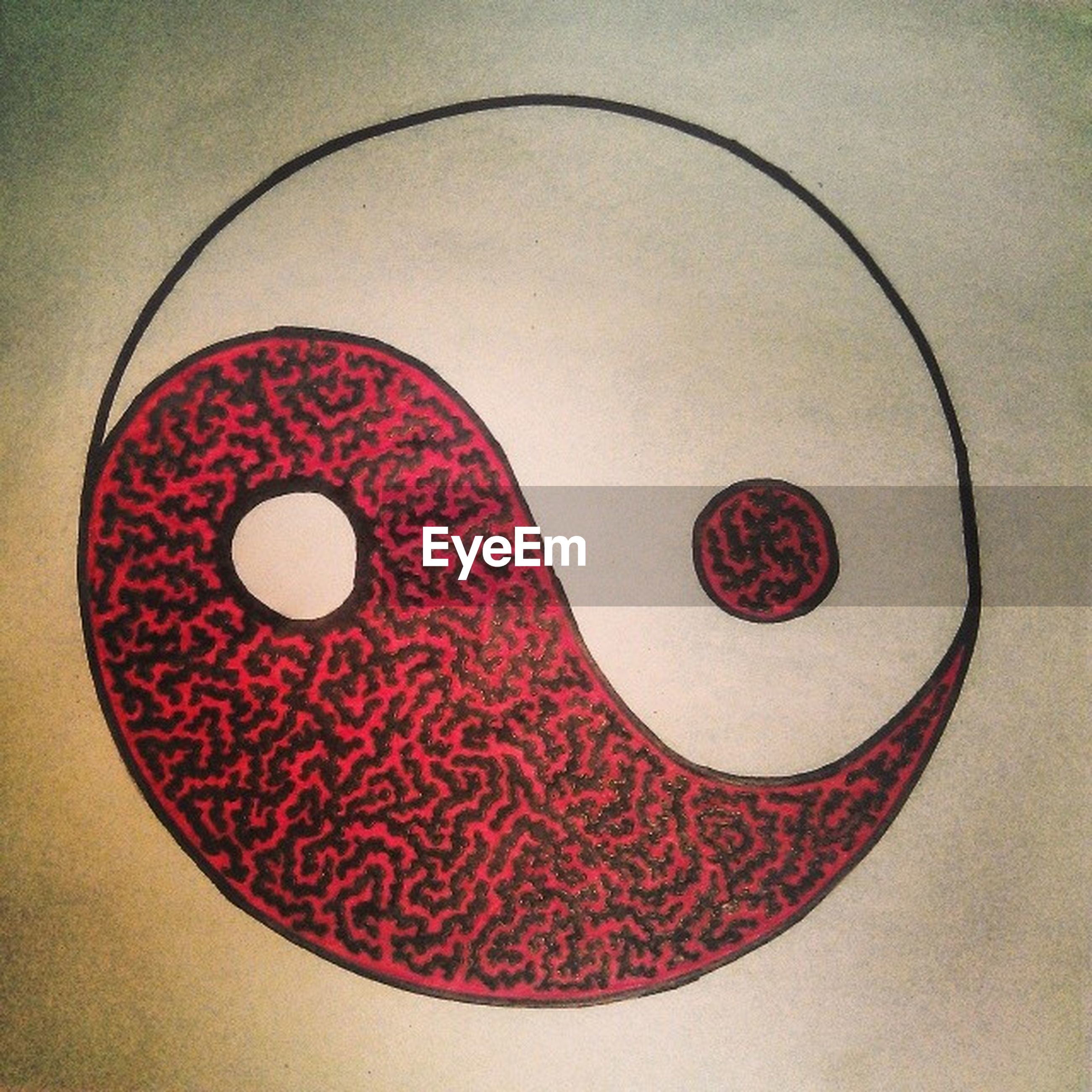 indoors, circle, red, geometric shape, close-up, communication, still life, high angle view, heart shape, creativity, pattern, text, no people, shape, art, art and craft, directly above, table, western script, wall - building feature