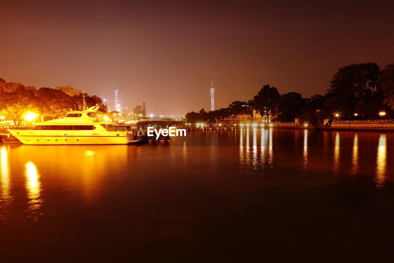 illuminated, night, water, architecture, waterfront, built structure, reflection, city, building exterior, outdoors, nautical vessel, no people, sky, travel destinations, sea, cityscape