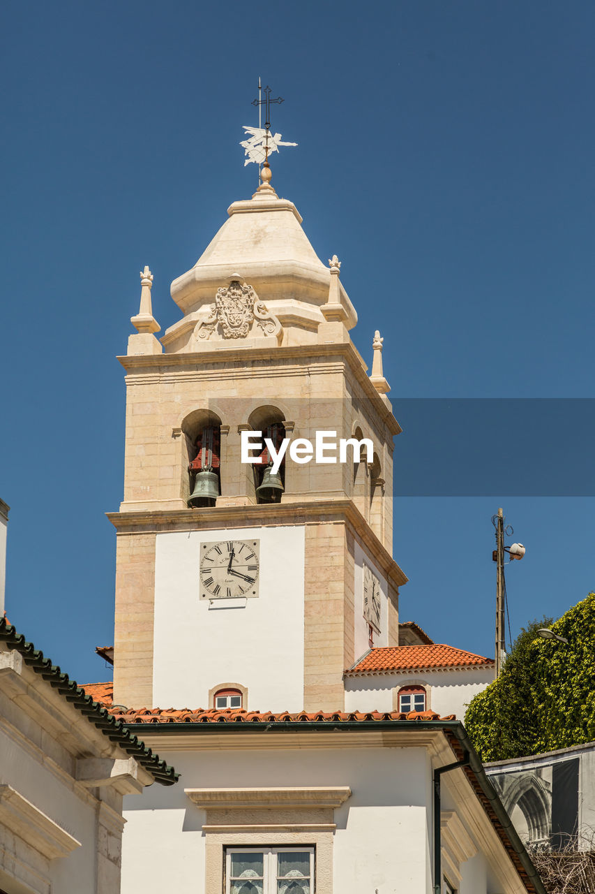 architecture, built structure, building exterior, building, place of worship, sky, belief, religion, tower, spirituality, nature, clear sky, bell tower - tower, low angle view, blue, no people, sunlight, outdoors, clock, spire