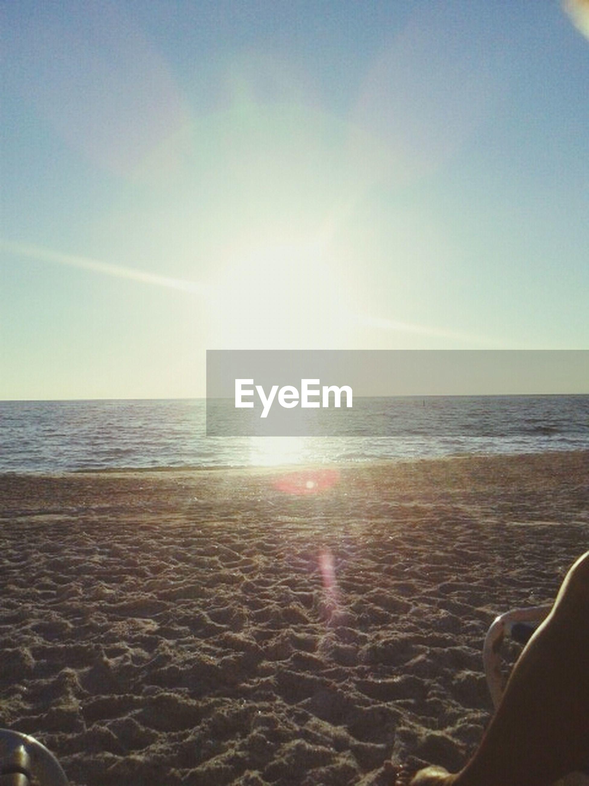 sea, beach, horizon over water, water, sand, sun, sunlight, sky, shore, scenics, tranquil scene, beauty in nature, tranquility, sunbeam, nature, sunny, idyllic, lens flare, day, remote