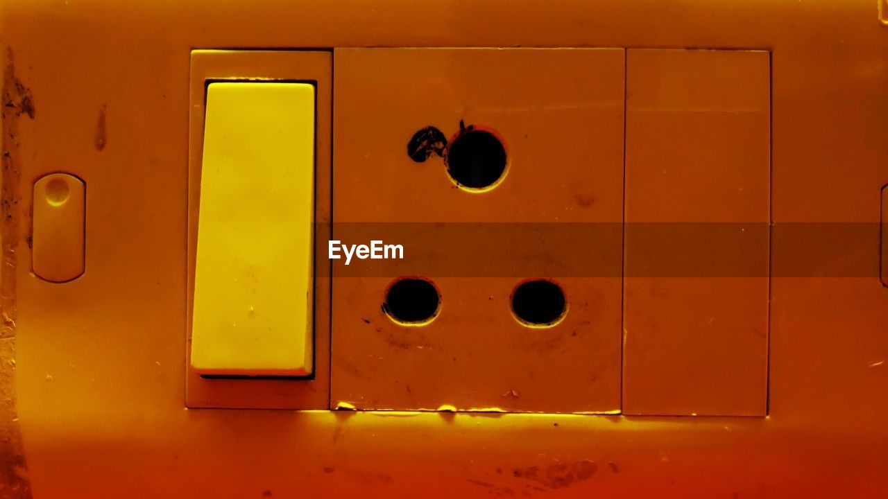 no people, yellow, full frame, metal, close-up, entrance, indoors, door, shape, security, closed, hole, geometric shape, orange color, backgrounds, locker, protection, safety, design, keyhole