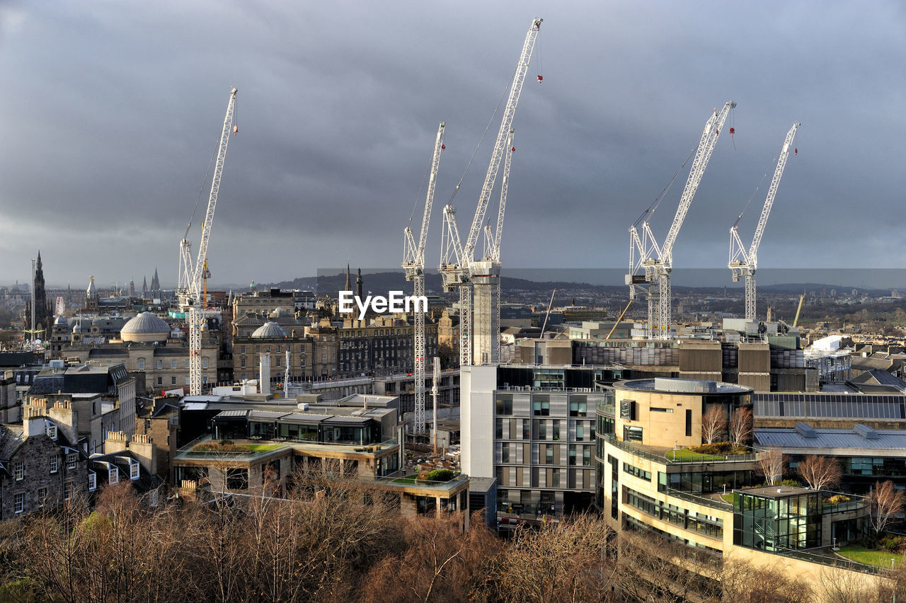 sky, architecture, cloud - sky, built structure, building exterior, industry, machinery, no people, nature, day, crane - construction machinery, outdoors, factory, city, construction industry, water, development, construction site, travel, high angle view, industrial equipment