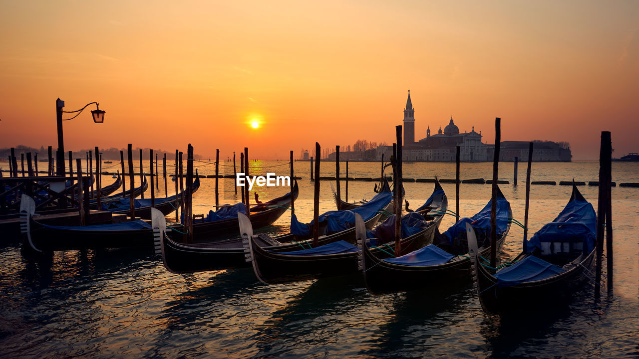 View Of Boats In Sea At Sunset