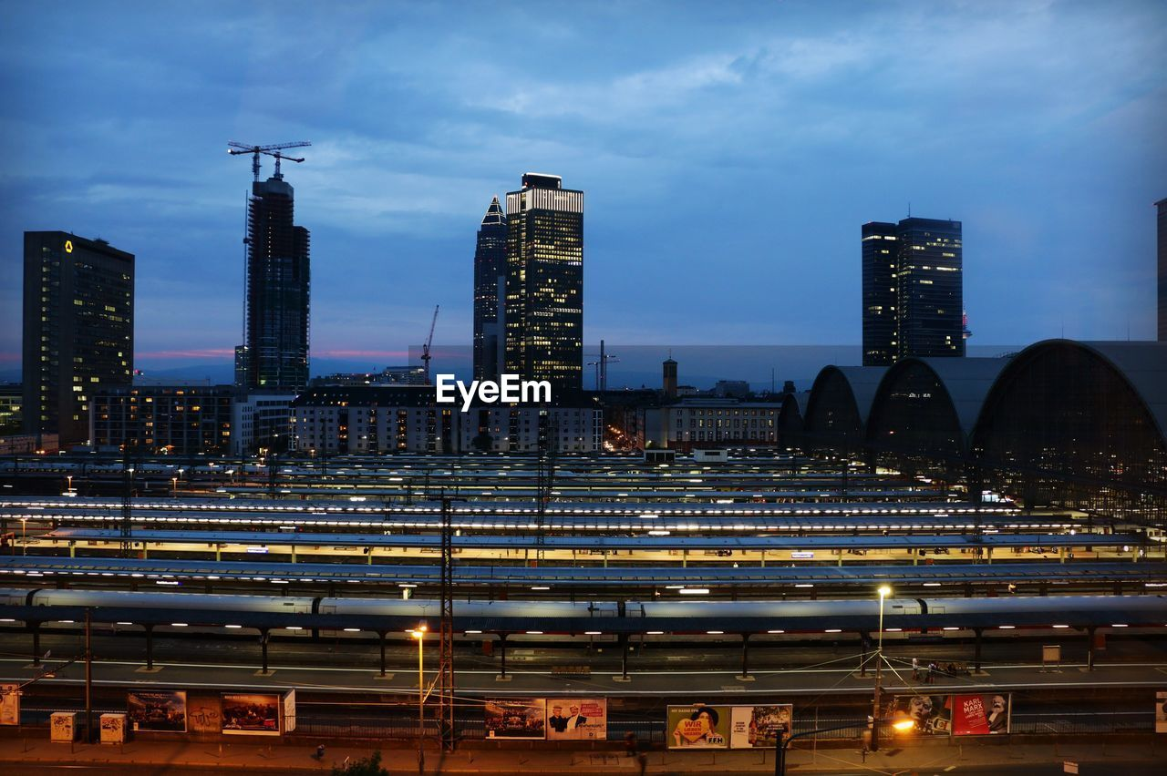 building exterior, built structure, sky, architecture, cloud - sky, illuminated, city, no people, nature, office building exterior, dusk, urban skyline, tall - high, cityscape, outdoors, building, skyscraper, night, transportation, modern